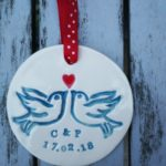 Lovebirds in teal with initials and wedding/engagement date, with red heart on a red ribbon, €12